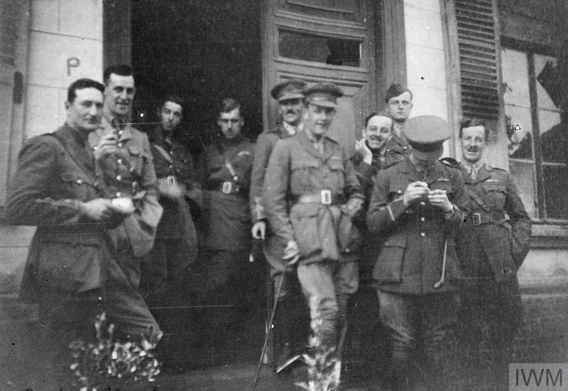 OFFICERS OF 'C' FLIGHT, 22 SQUADRON, R.A.F. OUTSIDE OF THE FLIGHT MESS AT BERTANGLES, NEAR AMIENS