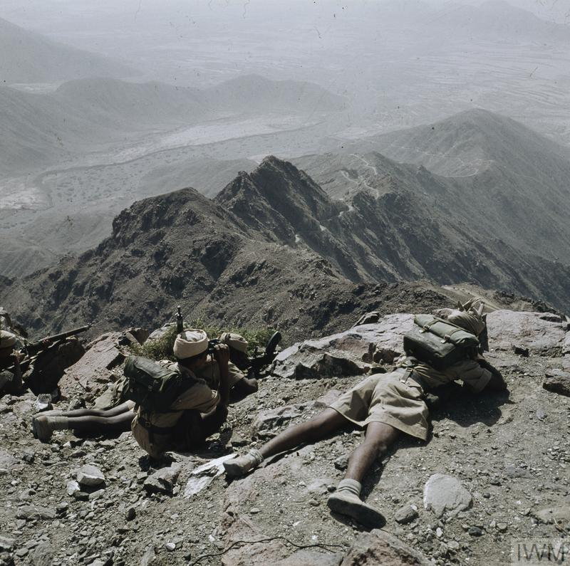 The Radfan Campaign: A section of infantry from the 2nd Battalion, Federal Regular Army taking up a hasty position on an escarpment during an exercise to test rapid movement in mountainous terrain near the garrison town of Mukeiras, situated high on an 8000ft plateau in the State of Audhali, some 120 miles east of Aden.