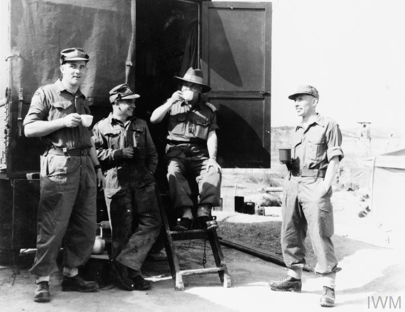 Warrant Officer William Tingey (British); Sergeant Thomas Metters (British); Captain Freddie Kup-Ferroth (Australian); and Staff Sergeant Ian Barker (British) (l to r) drink tea at the end of the day's work.