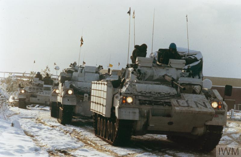 The arrival of British forces in Bosnia at the start of Operation GRAPPLE. A column of Warrior Armoured Fighting Vehicles belonging to A Company, 1 Cheshire Regiment, moves up from Split through winter landscape to the operating base at Vitez. The Warriors are painted in the high visibility white colour scheme identifying UNPROFOR vehicles.
