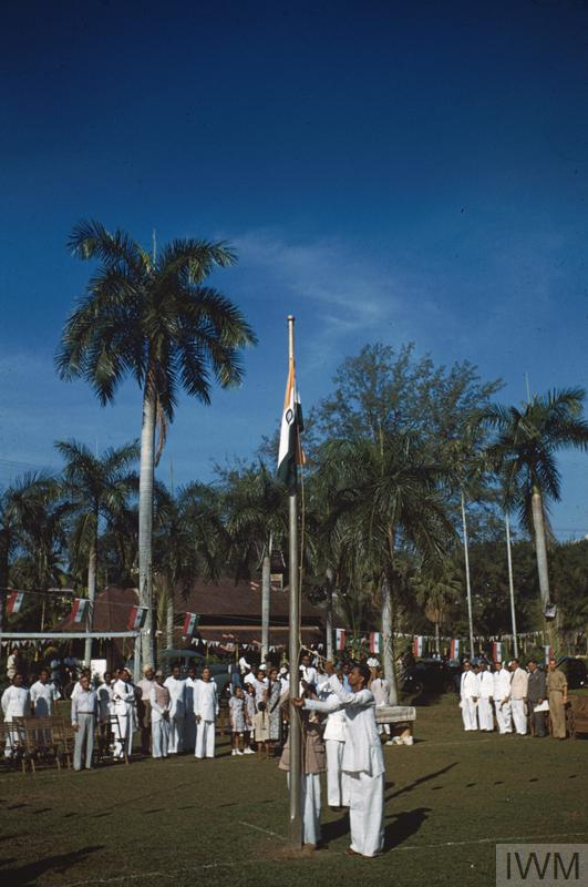Indian Independence is celebrated in Malaya shortly before the start of the Malayan Emergency. The Indian flag is raised at Klang, Selangor.