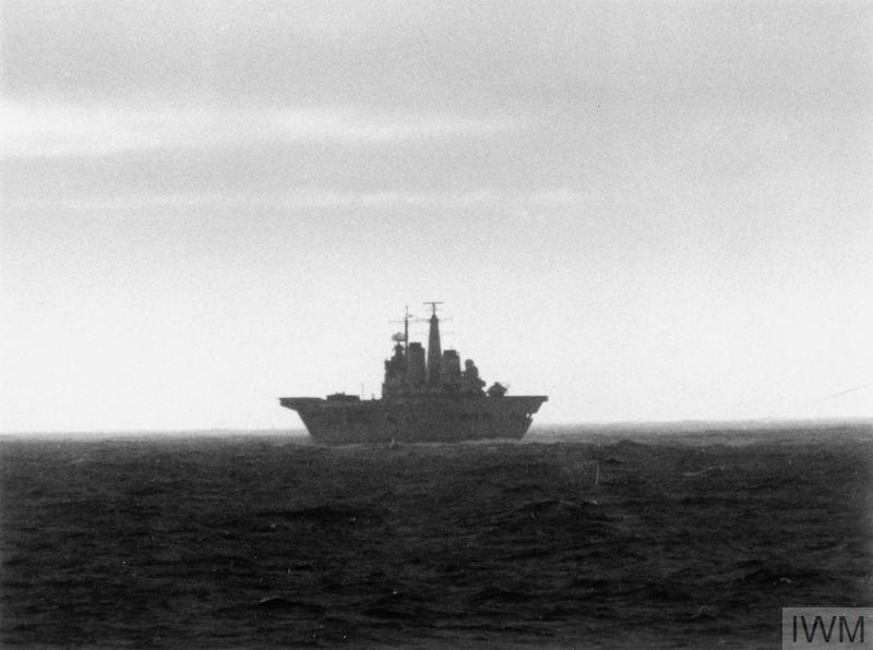 The aircraft carrier HMS Invincible, part of the British naval task force, silhouetted against the horizon as she sails towards the South Atlantic.