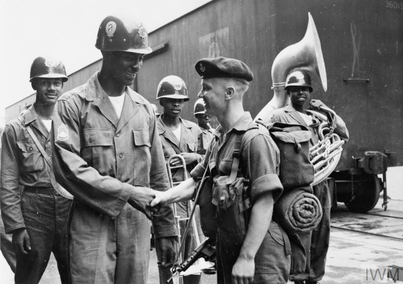 Private Ron Pattison, 1st Battalion, Durham Light Infantry, is greeted on his arrival in Korea by American Sergeant First Class Robert Tutt.