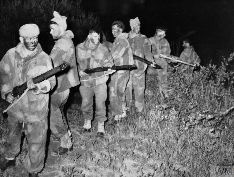 A British infantry patrol at night.