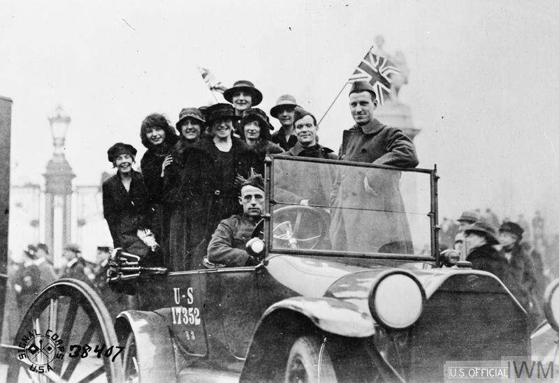 Happy girls in a US automobile in London
