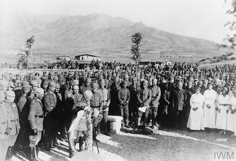 General Kuno von Steuben, the Commander of the German Eleventh Army, laying a wreath during the consecration ceremony of the German Military Cemetery at Prilep, Macedonia. Note German nurses present.