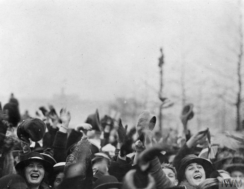 Crowd cheering outside Buckingham Palace during the Armistice Day, 11 November 1918.