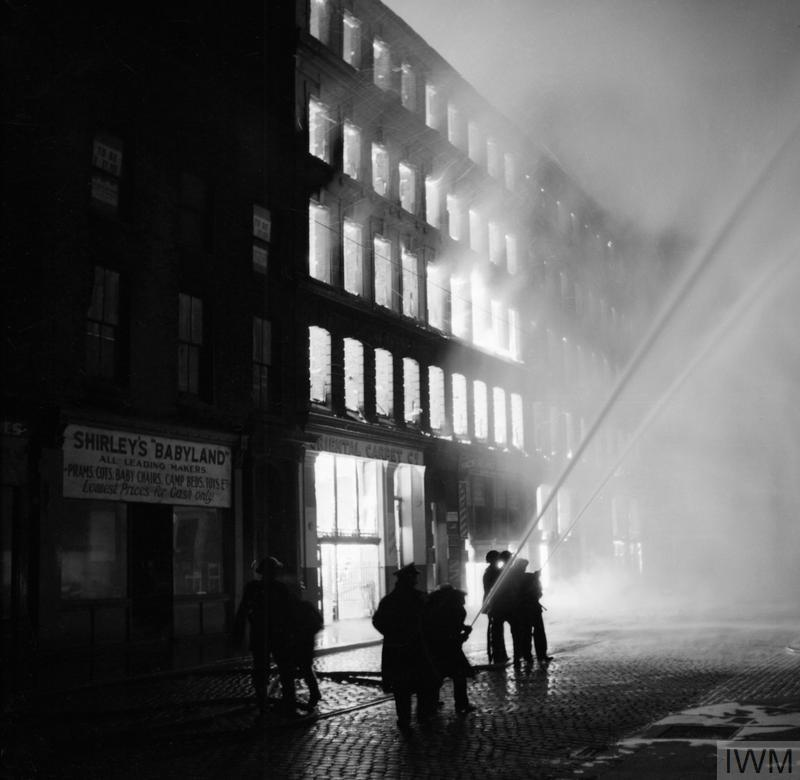 Fire fighters tackle fires burning in Manchester during an air raid on 23-24 December.