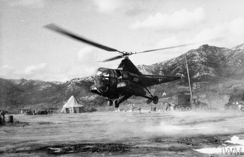 Sikorsky H-5 helicopter of the United States Air Force Rescue Service lands at a forward British ration point to collect supplies needed by units of the Commonwealth Division cut off by flooded roads in Korea.