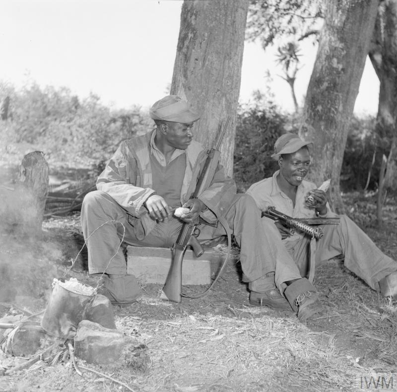 Kikuyu tribesmen working as members of a counter-gang tracking down Mau Mau insurgents. The work of counter-gangs including impersonating Mau Mau in order to obtain information.