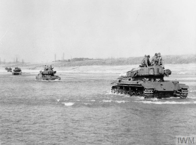 An American M46 Tank leads British Centurion Tanks across the Imjin River.