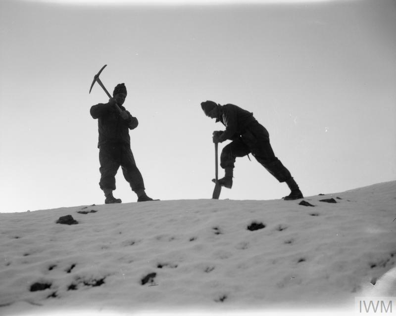 "Men of the 1st Battalion, The Royal Ulster Rifles dig trenches in ""Happy Valley"", north of Seoul, just before the Chinese attack of 2 January 1951."