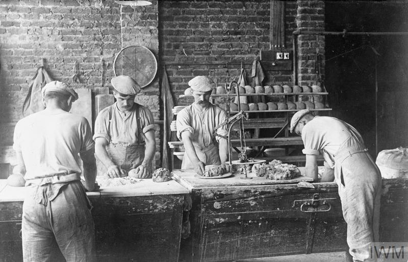 Bread being made in a German Army field bakery at Wervicq in Flanders.