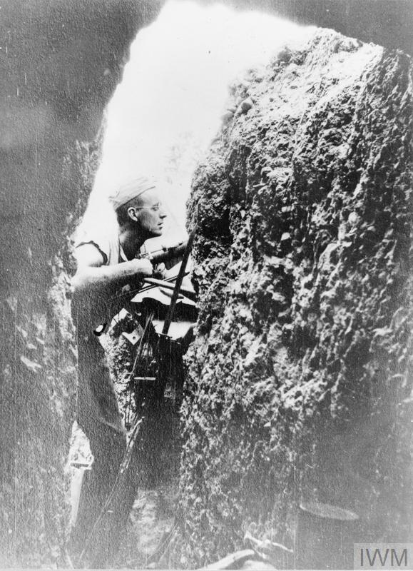 Trooper A M Maxwell (afterwards Captain Maxwell, 52nd Battalion), 3rd Light Horse Regiment sniping up Dead Man's Gully from Quinn's Post, Gallipoli. Photograph taken from the entrance to the tunnel in which the soldiers slept.