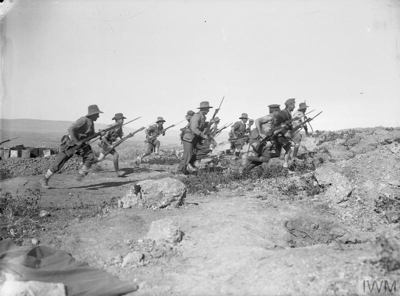 Posed photograph of Australian troops charging uphill with fixed bayonets, probably taken on Imbros or Lemnos, December 1915.
