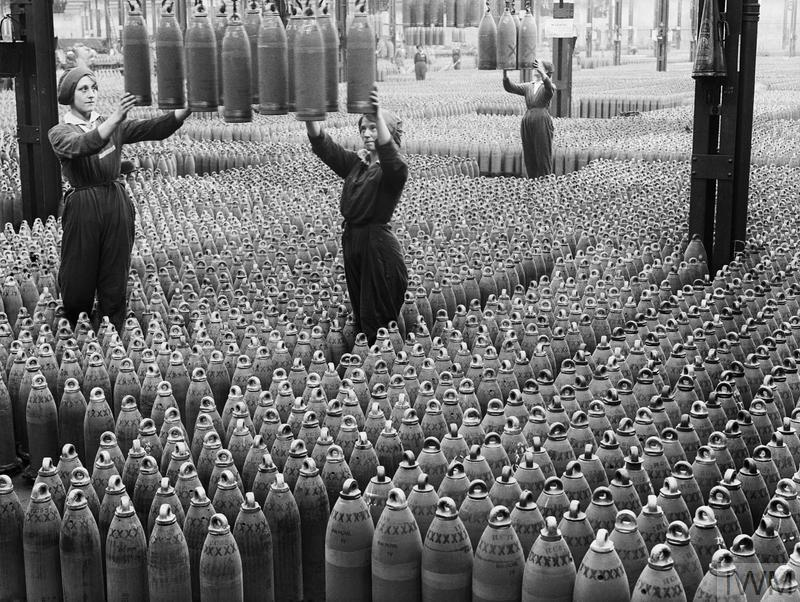 Female munitions workers guide 6-inch howitzer shells being lowered to the floor at the National Shell Filling Factory in Chilwell, Nottinghamshire around 21 August, 1917.