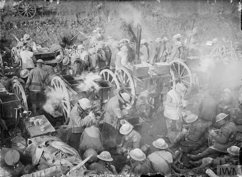 British troops receiving dinner rations from field kitchens in the Ancre area of the Somme, October 1916.