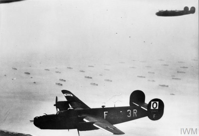 Consolidated B-24H Liberators of 486th Bombardment Group, US Eighth Air Force, flying over part of the Allied invasion fleet gathered off the Normandy coast, 6 June 1944. They were part of a force of 380 aircraft of 3rd Bombardment Division despatched on the morning of D-Day to bomb villages through which access roads ran to the beachheads.