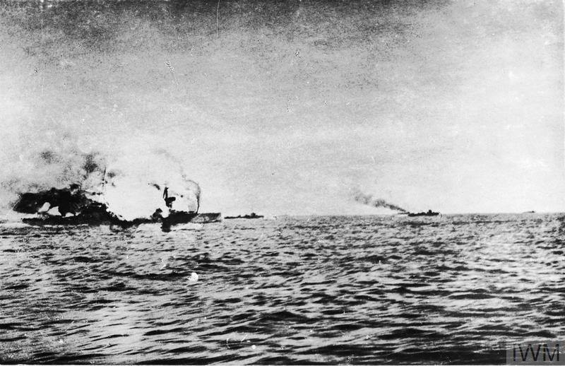 """HMS INVINCIBLE explodes during the battle of Jutland after she was hit five times by shells from the German battlecruisers DERRFLINGER and LUTZOW, the last hit blowing the roof off """"Q"""" turret and setting fire to the cordite propellant, the flash soon spread to the magazine and INVINCIBLE was ripped in two by the explosion. There were only three survivors with those killed including Rear-Admiral The Hon Horace Hood. The photograph appears to have been heavily retouched."""