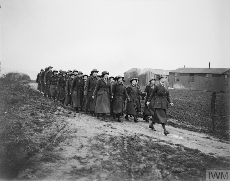 A party of WAACs marching through the ruins of Etaples, 5 April 1918.