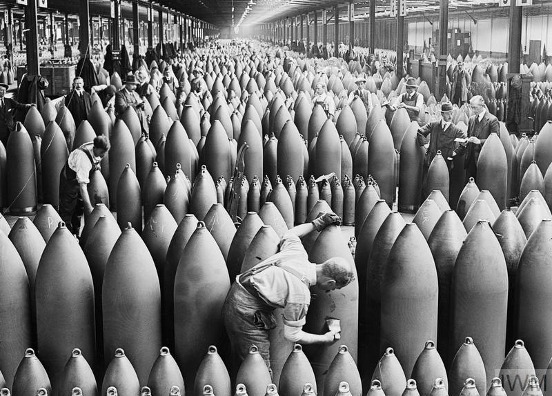 Munition workers painting shells at the National Shell Filling Factory, Chilwell, Nottinghamshire around 21 August, 1917. This was one of the largest shell factories in the country.