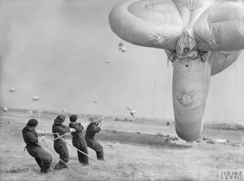The Women's Auxiliary Air Force (WAAF): Aircraftwomen learning how to handle a barrage balloon at the training station at Cardington.