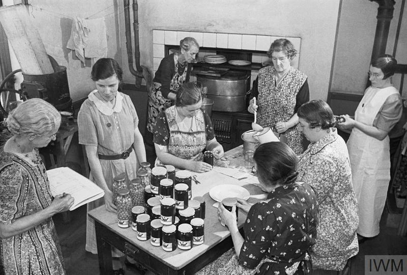 Women in the Voluntary Services: Women's Institute members at a jam-making centre on the east coast of England. Large amounts of jam and bottled fruit were produced by the WI to preserve the summer crops of fruit.