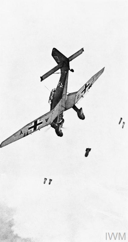 Bombs falling away from a Junkers Ju-87 Stuka dive-bomber. The photograph appears to have been taken from a following aircraft.