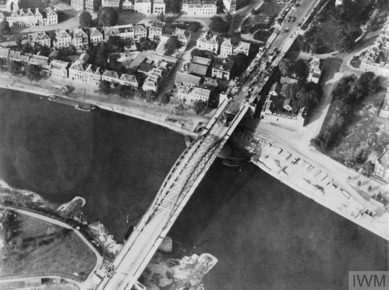 Aerial view of the bridge over the Neder Rijn, Arnhem; British troops and armoured vehicles are visible at the north end of the bridge. Had General Montgomery's ambitious scheme for seizing the Rhine bridges succeeded the war in Europe might have been shortened by many months. In the event, however, back-up forces were unable to come up quickly enough to enable the advanced airborne troops to hold the strategically vital bridge at Arnhem.