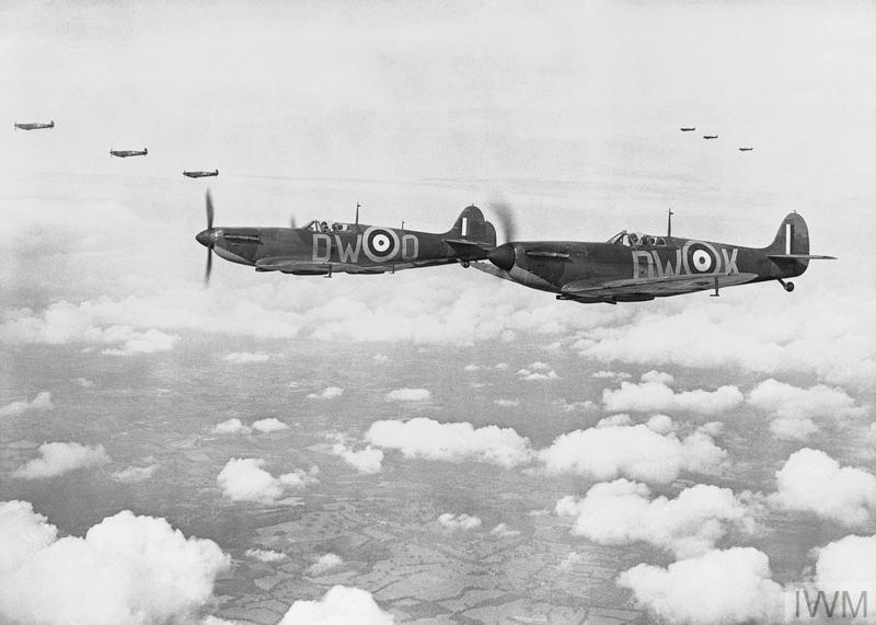 Supermarine Spitfire Mark IAs, (N3289 'DW-K and R6595 'DW-O' nearest), of No 610 Squadron, Royal Air Force based at Biggin Hill, Kent, flying in three 'vic' formations.