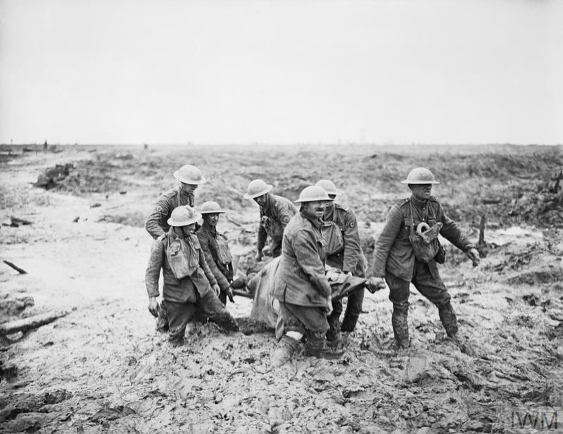 Battle of Pilckem Ridge. Stretcher bearers struggle in mud up to their knees to carry a wounded man to safety near Boesinghe, 1 August 1917.