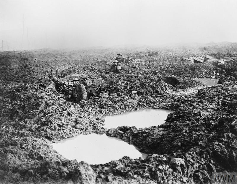 Men of the 16th Canadian Machine Gun Company holding the line in a landscape of mud and water-filled shell holes, November 1917.