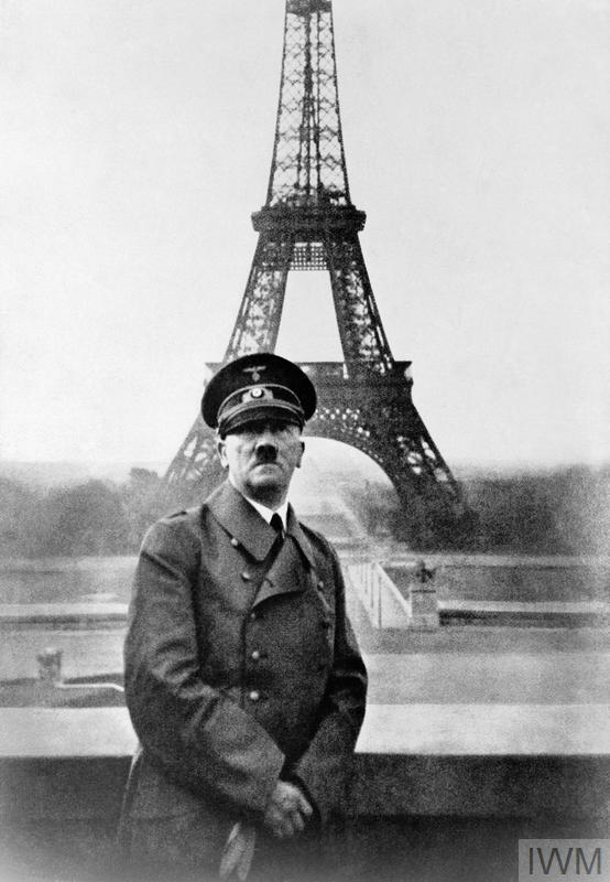 Adolf Hitler standing at the Trocadero, Paris, with the Pont d'Iena and the Eiffel Tower in the background, during his only visit to the French capital, 28 June 1940.