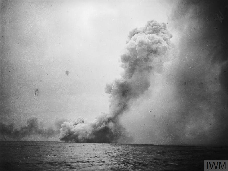 """A huge cloud of smoke rises when HMS QUEEN MARY blows up thirty eight minutes into the battle of Jutland after being struck by a salvo from the German battlecruiser DERFFLINGER. QUEEN MARY blew up after being hit by two 12 inch shells on """"A"""" and """"B"""" turret and their respective magazines were detonated, 1,266 men lost their lives."""