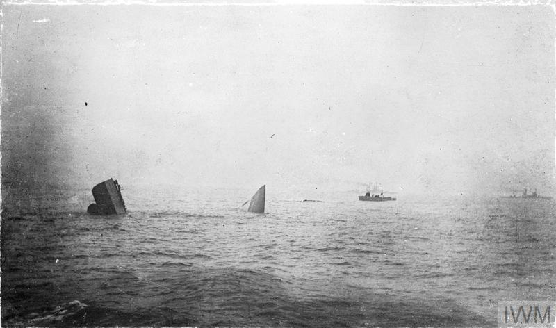 "The bow and stern of HMS INVINCIBLE sticking out of the water as the battlecruiser sinks during the battle of Jutland after she was hit five times by shells from the German battlecruisers DERRFLINGER and LUTZOW, the last hit blowing the roof off ""Q"" turret and setting fire to the cordite propellant, the flash soon spread to the magazine and INVINCIBLE was ripped in two by the explosion."