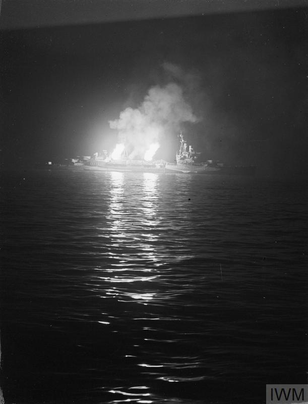 Starboard 4 inch guns of HMS BELFAST open fire on German positions around Ver-sur-Mer on the night of 27 June 1944.