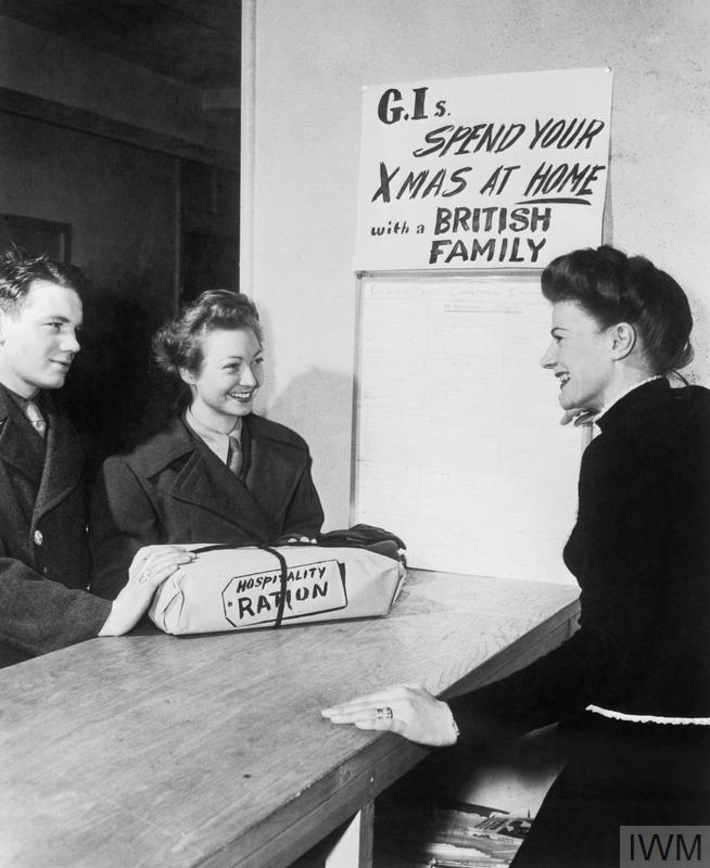 An American serviceman and a member of the Women's Army Corps at a Red Cross Club.