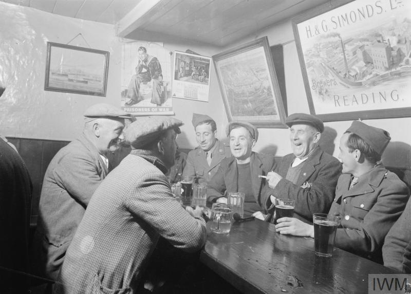 Off Duty: Locals and United States troops meet at the Dove Inn, Burton Bradstock, Dorset, 1944.