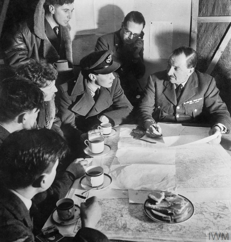 The Royal Air Force: A bomber crew is debriefed after their return from a night raid.