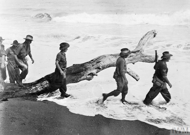 (© IWM AUS 2037) The Campaign in New Guinea, December 1942 - 1943: Australian soldiers advance along the coast toward Salamaua.
