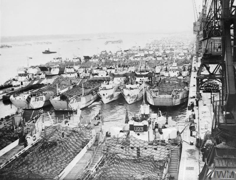 A large group of LCTs (Landing Craft Tank) moored along the quayside at Southampton, 1944.