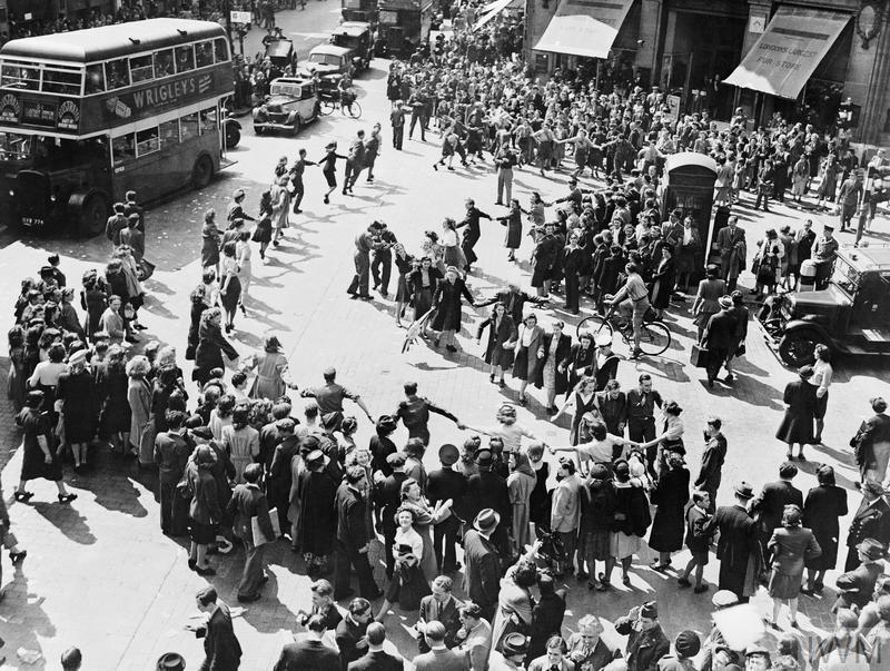 Crowds dancing in Oxford Circus, London.