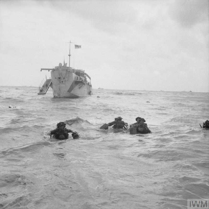 Troops wading ashore from an LCI(L) on Queen beach, Sword area, 6 June 1944.
