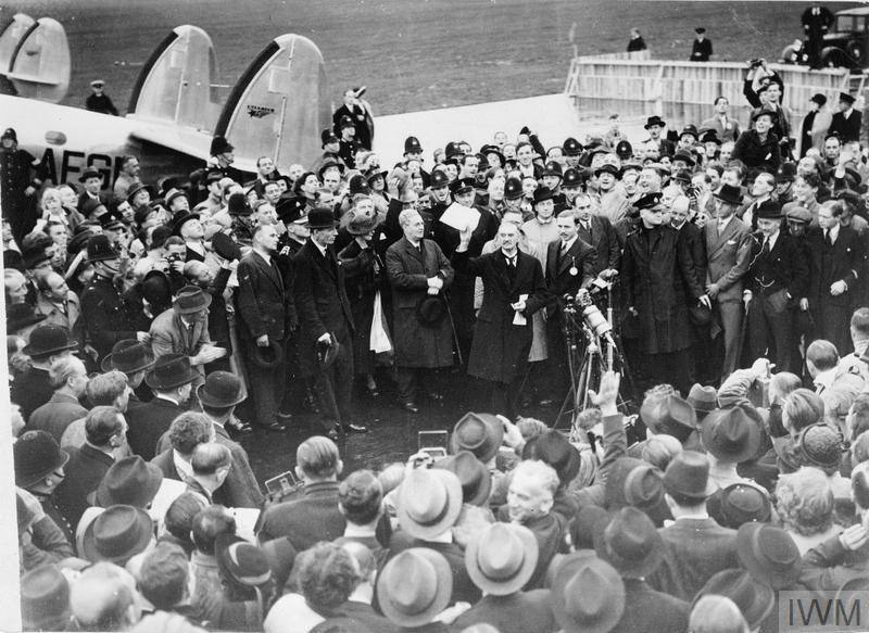 """Neville Chamberlain, the Prime Minister, makes a brief speech announcing """"""""Peace in our Time"""""""" on his arrival at Heston Airport after his meeting with Hitler at Munich, 30 September 1938."""