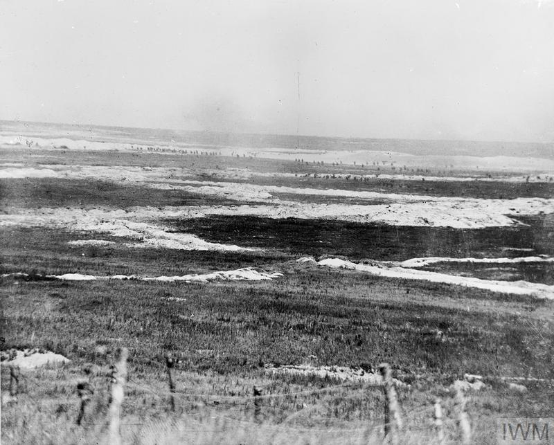 Somme Offensive, Battle of Albert. Panoramic view of British troops, visible as dots just below the horizon, attacking German trenches near Mametz, on 1 July. The trench lines are clearly marked by the white chalk excavated during their construction.