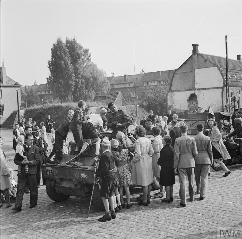 Nijmegen and Grave 17 - 20 September 1944: Vehicles of the Guards Armoured Division of the British XXX Corps passing through Grave having linked up with 82nd (US) Airborne Division.
