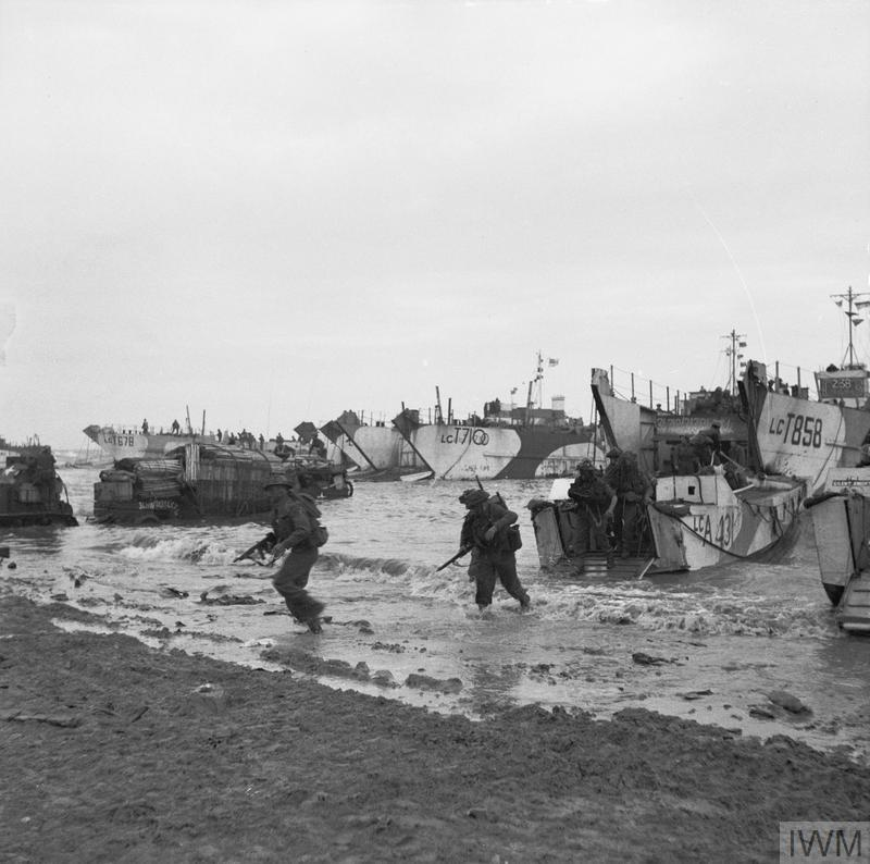 Commandos of 47 (RM) Commando coming ashore from LCAs (Landing Craft Assault) on Jig Green beach, Gold area, 6 June 1944. LCTs can be seen in the background unloading priority vehicles for 231st Brigade, 50th Division.