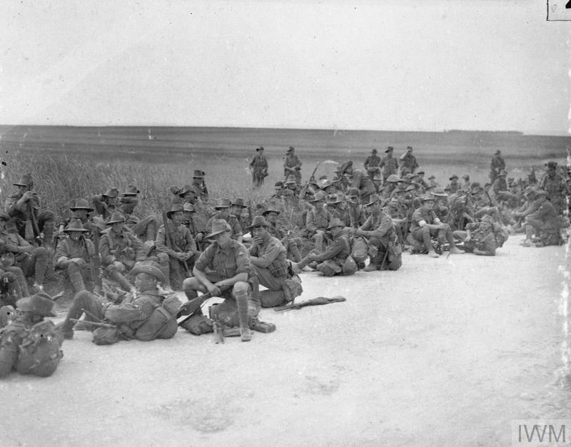 Battle of Pozieres Ridge 23 July - 3 September: Men of the 2nd Australian Division resting by the roadside on their way to the Somme area.