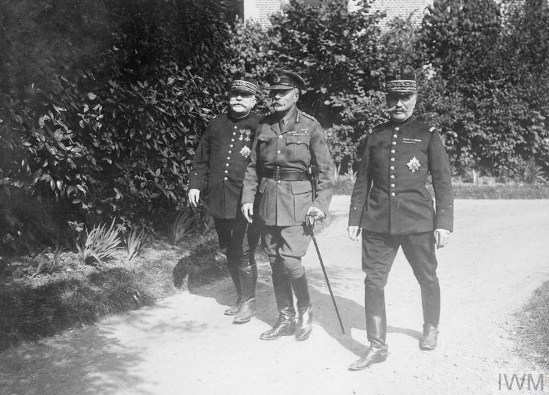 General Joseph Joffre, the C-in-C of the French Army; General Ferdinand Foch, the Commander of the French Army on the Somme; and General Douglas Haig, the C-in-C of the British Army, walking in the gardens at Beauquesne, 12th August 1916.