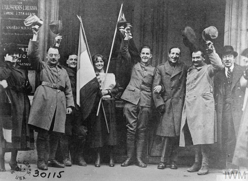 elgian girls with English, French and American troops during the Armistice celebrations in Belgium, 11 November 1918.